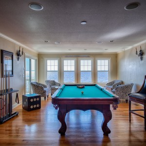 Sandmark custom remodel. Photograph of pool table in a recreational room