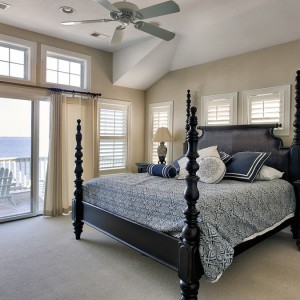 Sandmark custom remodel. Photograph of bed in carpeted bedroom