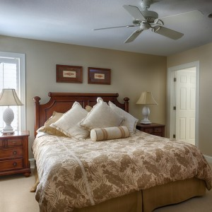 Sandmark custom remodel. Photograph of carpeted bedroom