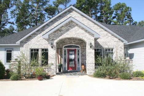 Sandmark custom remodel. Photo of front exterior of a custom home